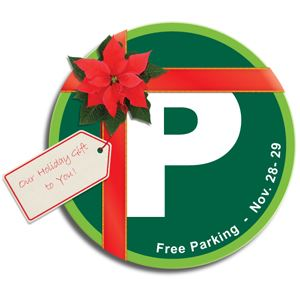 Parking logo with a red bow wrapped around it