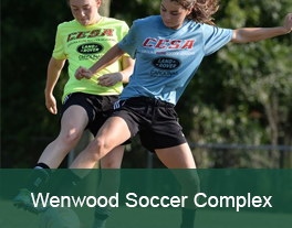 Two girls playing soccer at Wenwood Soccer Complex